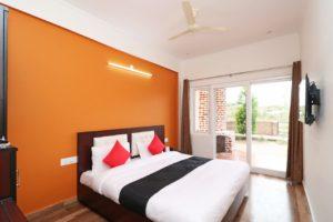romantic couple room with private lawn Cottages@Village Naukuchiatal