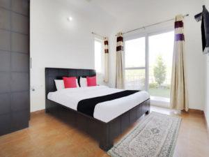 junior-suite with lawn at Cottages@Village Naukuchiatal